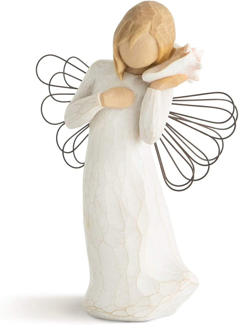 Ceramic figurine angel on a shell christmas angel