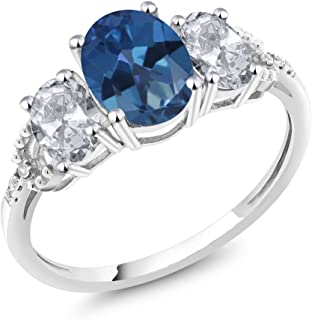Gem Stone King 10K White Gold Diamond Accent 3-Stone Engagement Ring set with 2.35Ct Oval Blue Mystic Topaz White Topaz