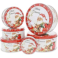white and red Christmas tins with Santa