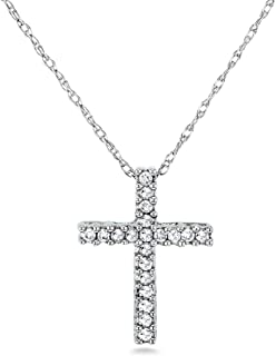 white gold cross with diamond in center