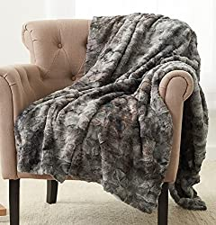 grey blanket thrown over a chair