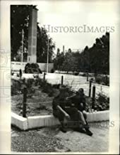 Historic Images - 1969 Press Photo Israeli Boy and Girl Soldier Sit in Front of Memorial at Camp