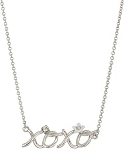 "Blue by Betsey Johnson Silver with Crystal and Flower Accented ""XOXO"" Necklace"