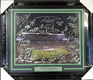 Seattle Seahawks Super Bowl XLVIII Champion Signed Framed 16 x 20 Photo With 26 Signatures Including Russell Wilson Marshawn Lynch and Richard Sherman - Autographed NFL Football Photos