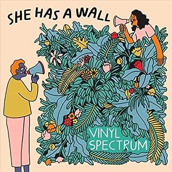 She Has a Wall