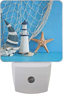 Naanle Set of 2 Nautical Theme Sailboat Lighthouse Starfish Seashells Fishnet Over Blue Wooden Table White Decorative Auto Sensor LED Dusk to Dawn Night Light Plug in Indoor for Adults