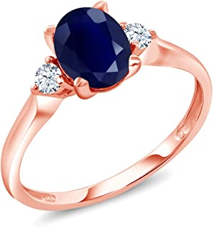 Gem Stone King 10K Rose Gold Blue Sapphire and White Created Sapphire 3-Stone Women's Ring 1.89 Ctw Oval (Available 5,6,7,8,9)