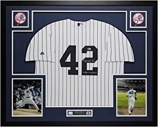 Mariano Rivera Autographed Pinstriped New York Yankees Jersey - Beautifully Matted and Framed - Hand Signed By Mariano Rivera and Certified Authentic by Beckett - Includes Certificate of Authenticity