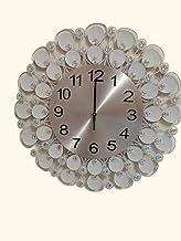 ساعة حائط أنيقة مزخرفة لون أبيض