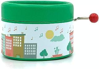 Caja de música color verde con un estampado de ciudad de música y la canción Moon River