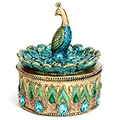 Keep your most treasured trinkets and jewellery in this lovely golden box, adorned with faux turquoise and aqua crystals on the circular box base. The royal peacock top with curved turquoise feathers can hold rings and earrings in place. A dramatic p...