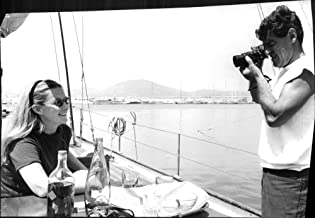 Vintage photo of Jean-Claude Brouillet taking photograph of Marina Vlady.