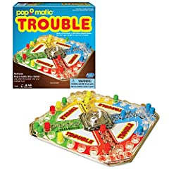 """POP-O-MATIC """"TROUBLE"""". Looks just like the Trouble you remember. The Play of the game is to be the first player to move all 4 of your pegs around the game board and into """"Finish"""" HEAD TO THE FINISH: Pop the dice in the Pop-O-Matic dice popper and see..."""