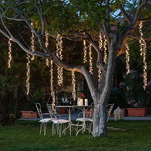 Warm wit koppelbaar led-huwelijkssnoer verlicht de lichtsnoer die voor een boomtuinfeest-weg-decoratie buiten wordt geleid