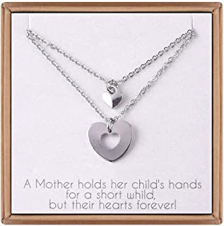 a mother holds her children's hands quote