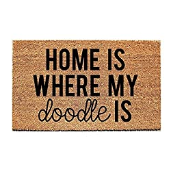 "Welcome mat that says, ""Home is Where My Doodle Is"" in black type, photo"
