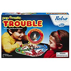 1986 Retro edition of the Trouble Game Classic game challenges players to get their pegs around the board The first player to reach the finish line wins Features full-size gameboard Includes plastic game unit with Pop-O-Matic die roller with wooden d...
