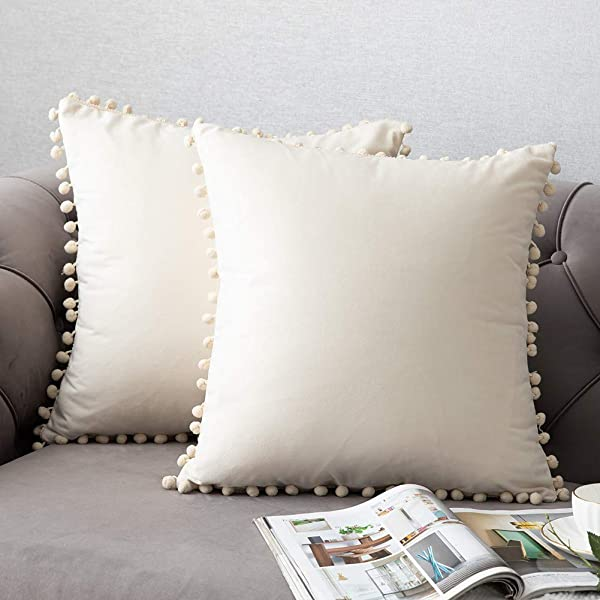 DEZENE Throw Pillow Covers With Pom Poms 2 Pack Super Soft Velvet Decorative Pillow Cases Luxury Accent Rectangular Pillowcases Square Cushion Covers For Farmhouse Couch Sofa 16x16 Inch Cream