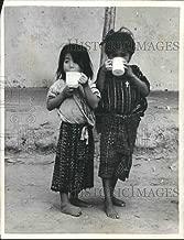 1962 Press Photo Guatemalan youngsters drinking mugs of milk at Santa Ana Xococ. - Historic Images