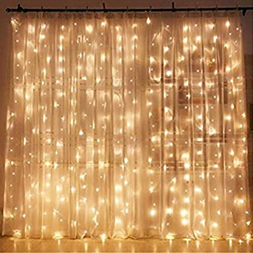Amazon Com Twinkle Star 300 Led Window Curtain String Light Wedding Party Home Garden Bedroom Outdoor Indoor Wall Decorations Warm White Home Kitchen