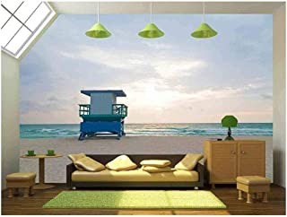 wall26 - Empty Beach with Lifeguard Cabin at Sunrise A Lonely Cabin on The Empty Beach - Removable Wall Mural | Self-Adhesive Large Wallpaper - 100x144 inches