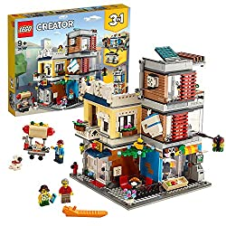 Three building opportunities with this LEGO creator 3-in-1 playset: The townhouse pet shop and café, a multi-floors bank or market street with tram The ground-level features a colorful facade with ornate detailing, decorative café signage and large w...