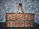 """Amish Handmade Large Picnic Basket with Pie Divider Tray and Wood Carrier Handles. Truly the Ultimate in Picnic Baskets! Place Your Homemade Pie in the Bottom of the Basket and Secure It By Placing the Divider on Top of It, Then Place Your Meal and Picnic Supplies Above the Divider. The Double Swinging Handles Balance Out This Handmade Basket When Carried Around. You Won't Find a Better Picnic Basket Around. This Is One of Our Best Sellers! Colors May Vary (Brown, Black, Red, Blue, Green, Purple, Burgundy, Natural) Base 20.25"""" L X 10.25 W - With a Degree Cut for Overall 24"""" L X 13.25w X 9.5 H."""