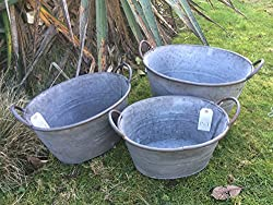 Set Of 3 Beautiful finish Galvanised zinc trough planter Metal Rustic Finish Metal Handles Would make a lovely feature in any garden or Home Dimensions including handle- Large- H-24cm x L-38cm x W-27cm Medium- H-21cm x L-35cm x W-24cm Small- H-18cm x...
