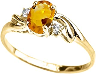 Exquisite 10k Yellow Gold Oval-Shaped November Birthstone with White Topaz 3-Stone Proposal Ring