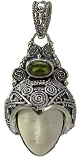 Carved Bone Face Pendant with Peridot Stone