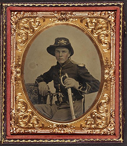 Unidentified soldier in Union uniform with gauntlets, shoulder scales, and cavalry Company K Hardee hat holding dual Colt Model 1855 Root sidehammer pistols and cavalry saber