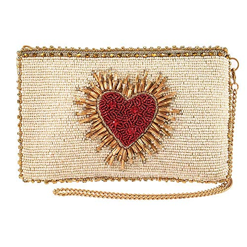 4. 75 x 0. 5 x 7. 75 Strap length: 49 Top hidden-magnet compartment, side zipper compartment, removable crossbody chain strap can be Switched to bottom D-ring to wear both vertical and horizontal, fits cell phone Hand beaded by skilled artisans