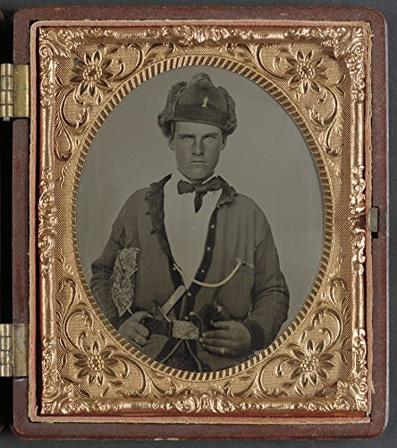 Historic Photos Unidentified soldier in Union uniform, U.S. cavalry belt, and fur hat bearing number 1, with Bowie knife and revolver