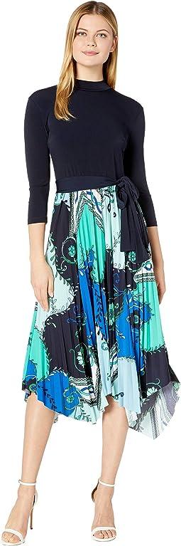 Long Sleeve Jersey Asymmetrical Hem Pleated Skirt Mock Neck Self Belt Dress
