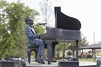 Photograph - Sculptor Andy Davis's revolving bronze statue of noted American singer Ray Charles in the small Ray Charles Plaza at Albany, Georgia's Riverfront Park 66in x 44in