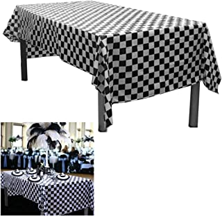 2 Black And White Checkered Plastic Tablecloths. Measures 54