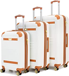 white and brown leather luggage