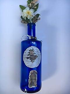 botella decorativa con adornos vintage
