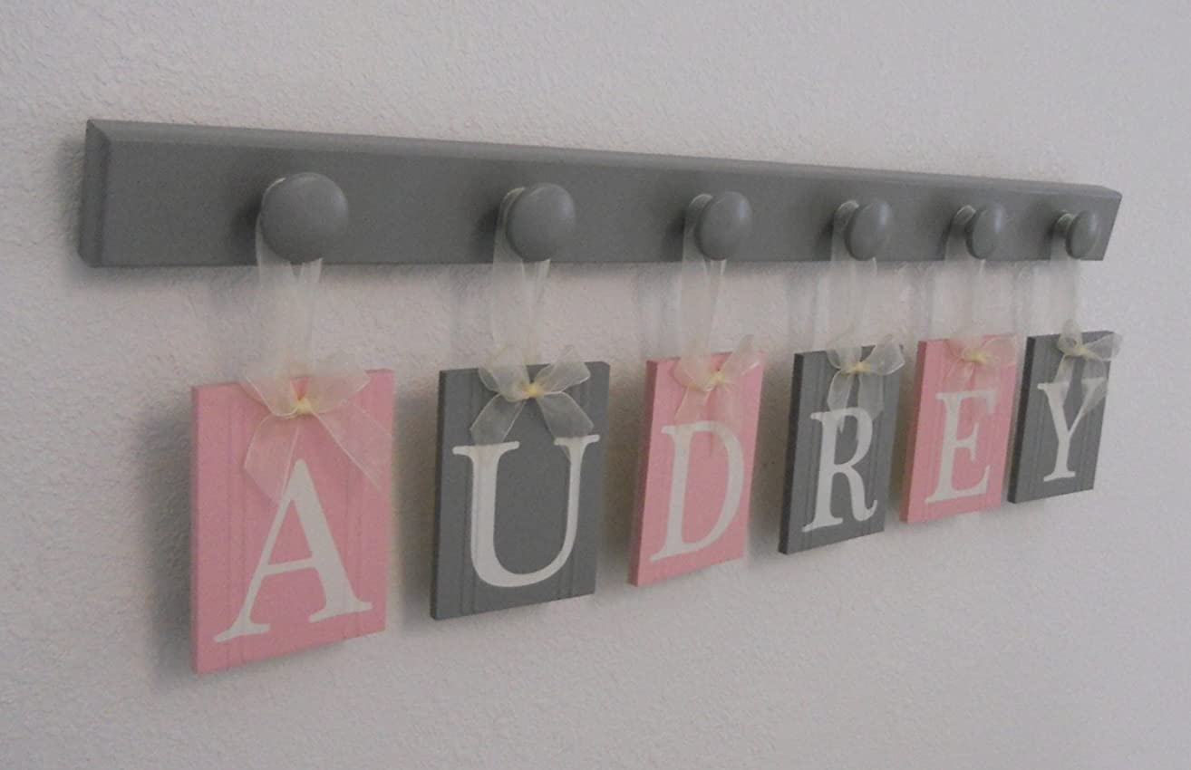 Baby Nursery Wooden Wall Letter Sign - Set Includes Wooden Pegs in Gray and Personalized Hanging Ribbon Name Tags Painted Light Pink and Grey