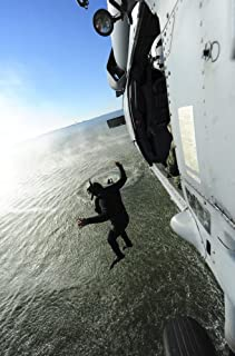 Posterazzi October 22 2012-A Naval air crewman Jumps from an MH-60S Sea Hawk Helicopter During Simulated Search and Rescue Operations Poster Print (22 x 34)