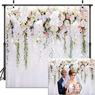 white curtain backdrop with flowers