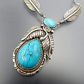 Pleasing handcrafted sterling silver Kingman turquoise feathers necklace wavy feather slide long pendant