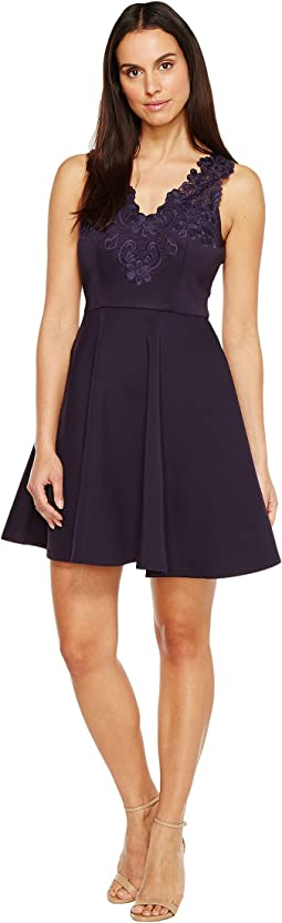 Taliia Halterneck Low V-Neck Dress