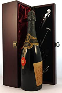 Veuve A Devaux Black Neck Vintage Champagne 1936 (2cm inverted ullage) in a silk lined wooden box with four wine accessori...