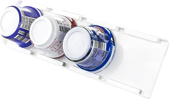 Four tubs of yogurt placed in yogurt holder inside fridge