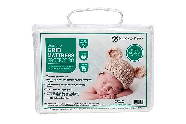 Ultra Soft Waterproof Crib Mattress Protector Pad From Bamboo Rayon Fiber by Margaux & May - Fitted Quilted Mattress Protector Pad for Your Crib.