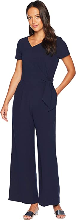 Petite Short Sleeve Crepe Jumpsuit with Asymmetrical Neck and Side Tie