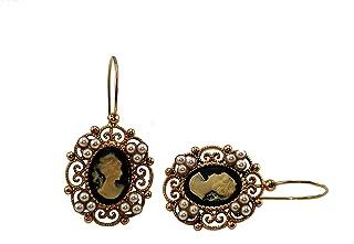 Orecchini Vintage Mokilu' in Ottone anallergico con doratura 24K effetto Oro Antico. Due cammei neri e delle piccole perle...