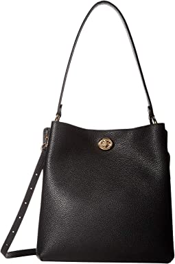 7f0b075626c4 COACH. Polished Pebble Leather Charlie Bucket.  375.00. New. Black Gold