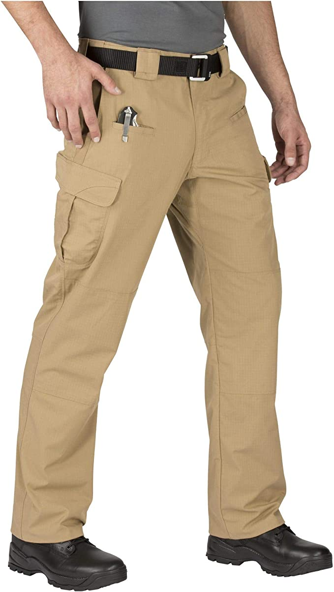 This is an image of a man wearing the 5.11 Tactical pants, coyote color, paired with a black belt and a heavy-duty black shoe.